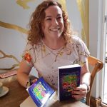 image of Smiley Coach Lisa Parkes at book signing for Stuck Between Two Worlds